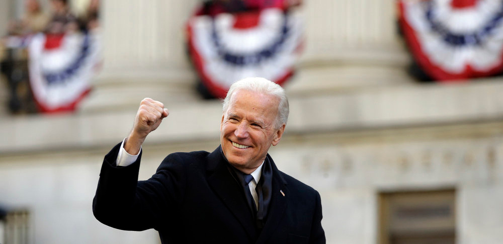 Description of . Vice President Biden walks down Pennsylvania Avenue en route to the White House, Monday, Jan. 21, 2013, in Washington. Thousands  marched during the 57th Presidential Inauguration parade after the ceremonial swearing-in of President Barack Obama. (AP Photo/Carolyn Kaster)