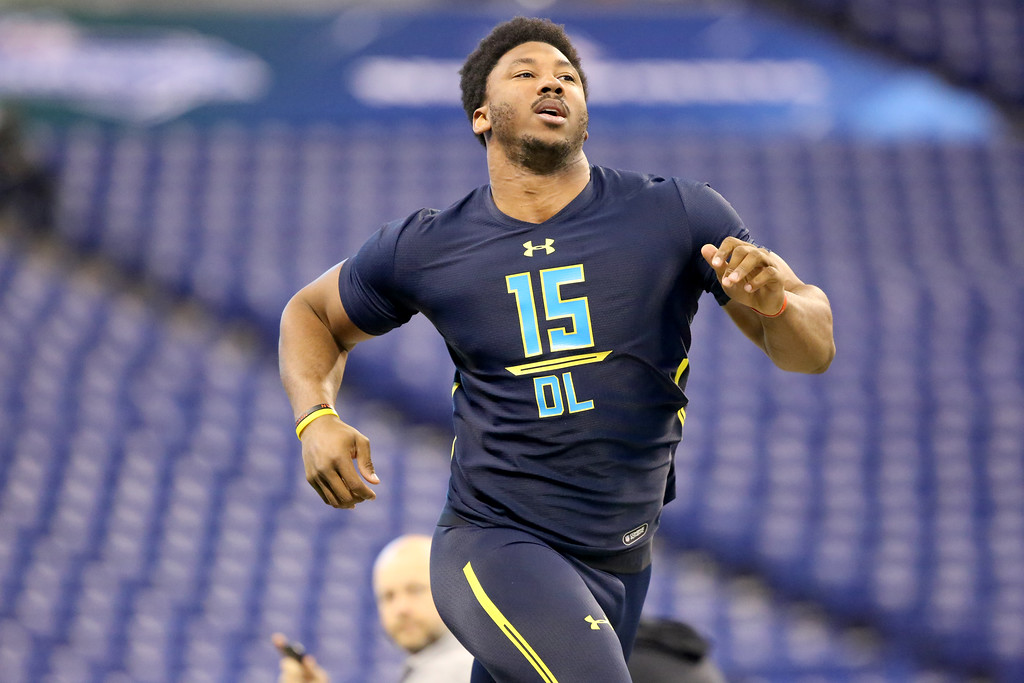 . Texas A&M defensive end Myles Garrett competes in the 40-yard dash at the 2017 NFL football scouting combine Sunday, March 5, 2017, in Indianapolis. (AP Photo/Gregory Payan)
