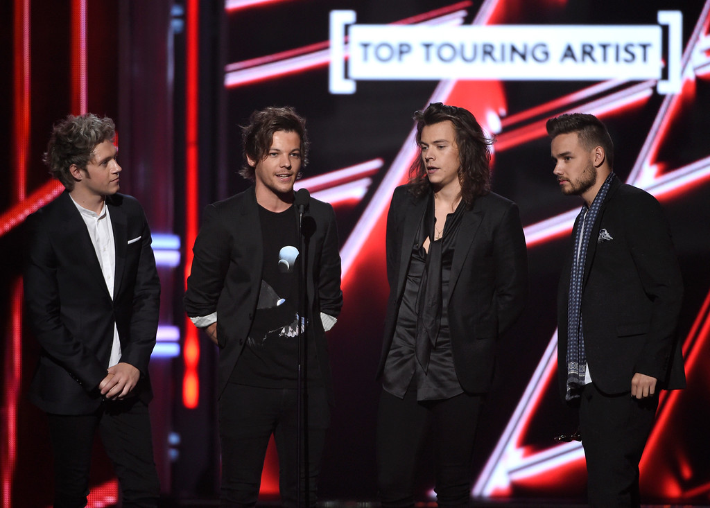 . Niall Horan, from left, Louis Tomlinson, Harry Styles, and Liam Payne of One Direction accept the award for top touring artist at the Billboard Music Awards at the MGM Grand Garden Arena on Sunday, May 17, 2015, in Las Vegas. (Photo by Chris Pizzello/Invision/AP)