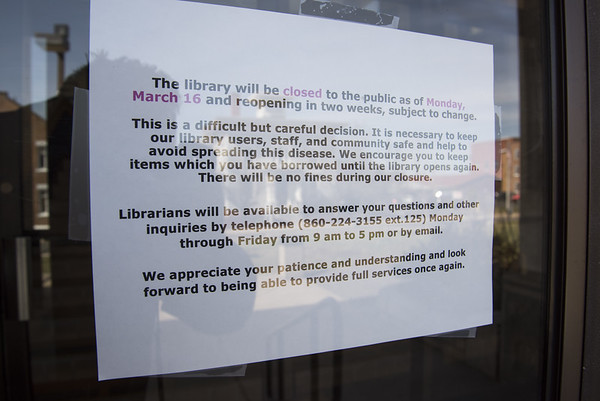 03/16/20 Wesley Bunnell | Staff A sign on the front door of the New Britain Public Library on Monday March 16, 2020 indicating they are closed for at least two weeks due to the Coronavirus.