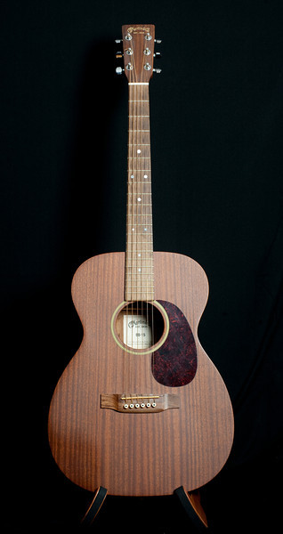 Martin 00-15. My favorite guitar and the one I play every day. The shadow on the lower left is from me and the way I hold it. He's called the Little Hog or Piglet.