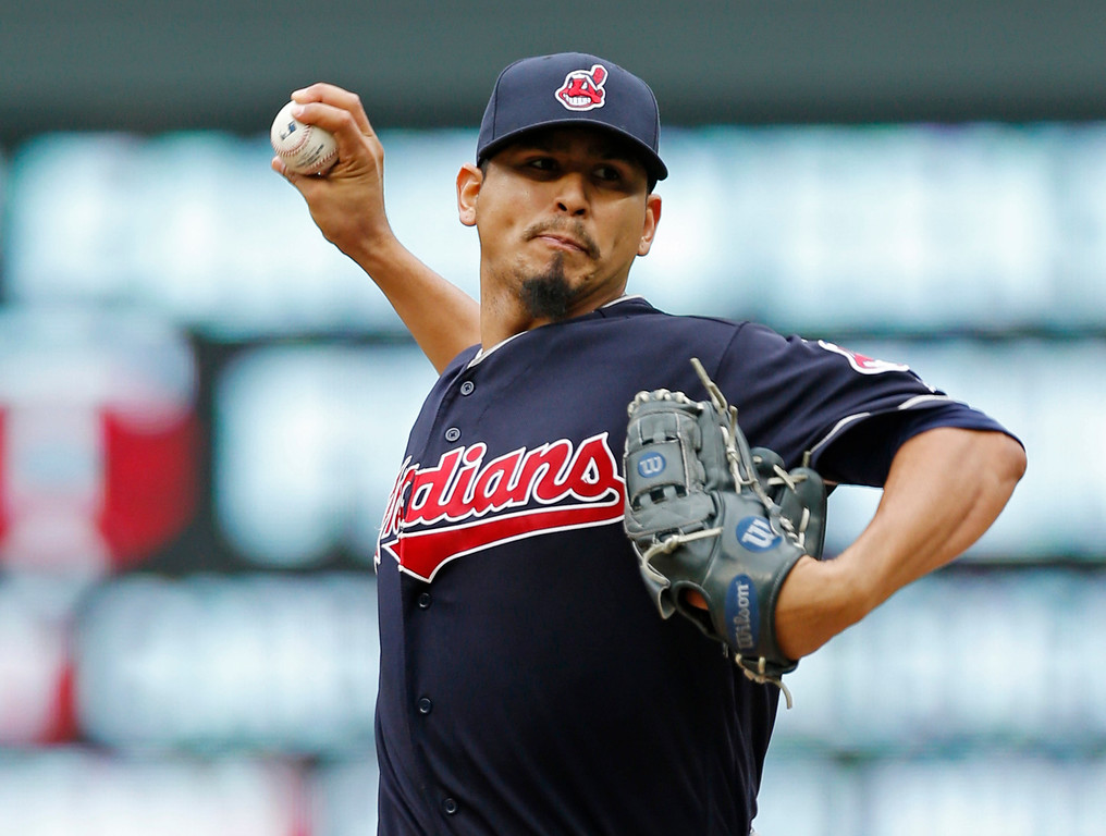 . Cleveland Indians pitcher Carlos Carrasco throws against the Minnesota Twins in the first inning of the first game of a baseball doubleheader Thursday, Aug. 17, 2017, in Minneapolis. (AP Photo/Jim Mone)