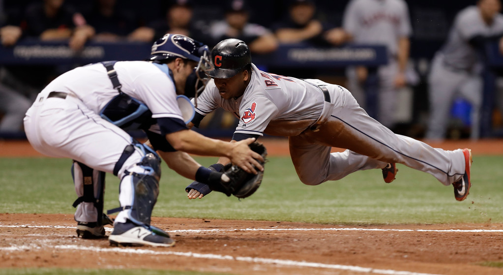 . Cleveland Indians\' Jose Ramirez scores ahead of the throw to Tampa Bay Rays catcher Nicholas Ciuffo on a fielder\'s choice by Yonder Alonso during the seventh inning of a baseball game Monday, Sept. 10, 2018, in St. Petersburg, Fla. (AP Photo/Chris O\'Meara)