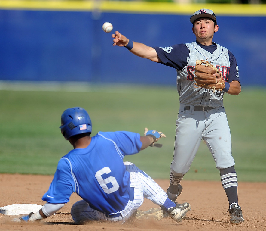 . St. Paul\'s Gabriel Esquer (4) forces out Bishop Amat\'s Daryl Daniels (6) in the third inning of a prep baseball game at Bishop Amat High School on Friday, April 19, 2012 in La Puente, Calif. Bishop Amat won 3-2.    (Keith Birmingham/Pasadena Star-News)