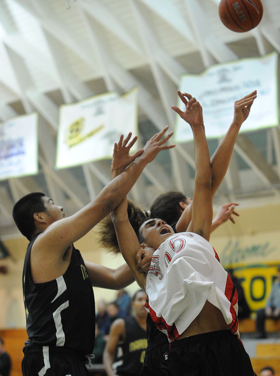 . Narbonne\'s Jan Franco (32) and Shailo Leafa (24) wrap-up Palos Verdes\' Auvied Homaizad (25) in a pool-play basketball game of the Mira Costa Pacific Shores Tournament Wednesday. Narbonne won the tight game 60-57. December 01, 2010.  Photo by Steve McCrank/Daily Breeze