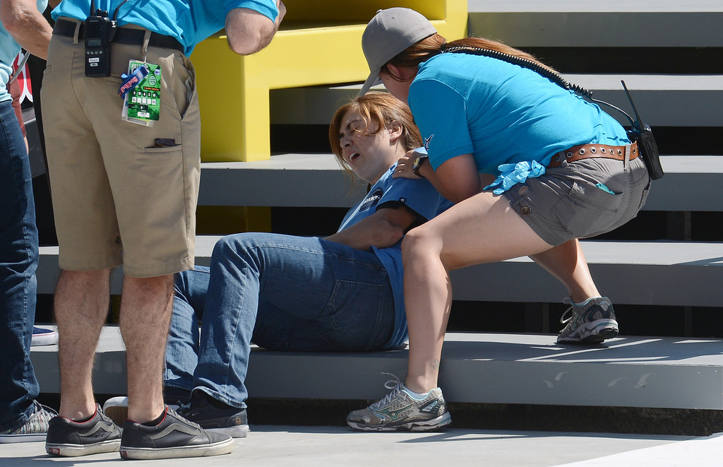 . Rachel Reinhard is attended to after injuring her arm during the  X Games Los Angeles Women\'s Skateboard Street Final at LA Live Thursday, August 1, 2013. (Hans Gutknecht/Los Angeles Daily News)