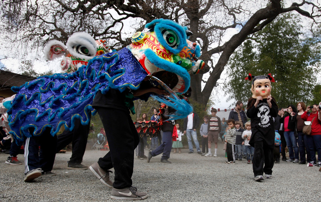 """. Dragon dancers from the Asian Cultural Dance Troupe entertain at the Hakone Estate and Gardens where a Lunar New Year of the Snake festival was hosted with a \""""Chinese Village Fair\"""" on Sunday afternoon, March 3, 2013 in Saratoga, Calif. (Karl Mondon/Staff)"""