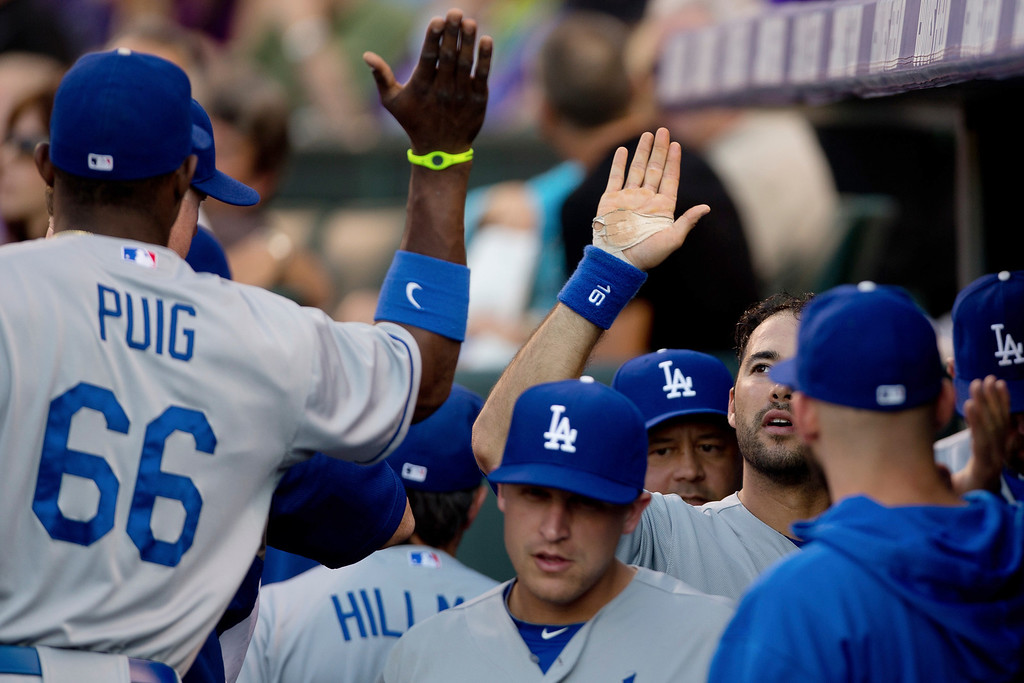 . Andre Ethier #16 of the Los Angeles Dodgers celebrates in the dugout after scoring the second inning against the Colorado Rockies at Coors Field on July 2, 2013 in Denver, Colorado.  (Photo by Justin Edmonds/Getty Images)