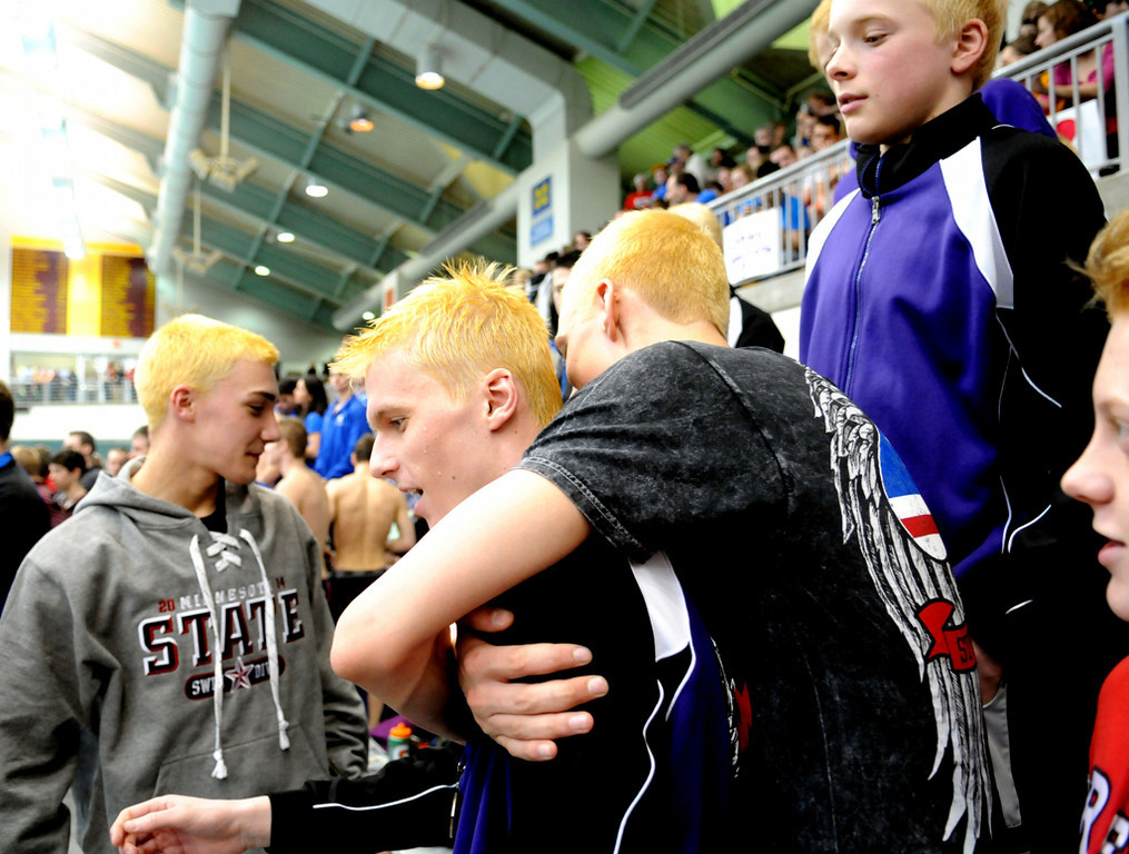 . Teammates of Red Wing\'s Tanner Alms congratulate him after his win in the 200 Yard Freestyle during the Class A State Swimming and Diving Meet. (Pioneer Press: Sherri LaRose-Chiglo)