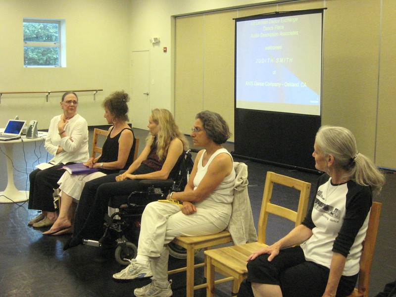 Martha Wittman of Liz Lerman/Dance Exchange speaks about Dance Exchange programs with older people.  To the right:  Liz Lerman, Judith Smith, Carla Perlo, and Esther Geiger, CMA (Certified Movement Analyst) with Audio Description Associates.