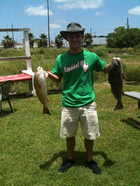 Mr Garrett Brooks with redfish and drum