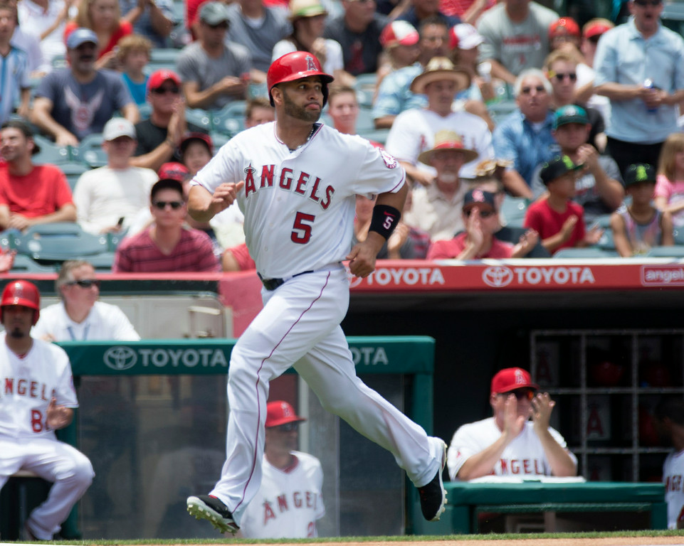 . Angels\' Albert Pujols (#5) scores as they play the Minnesota Twins at Angel Stadium in Anaheim on Thursday June 26, 2014. The Angels defeated the Minnesota Twins 6-4. (Photo by Keith Durflinger/Whittier Daily News)