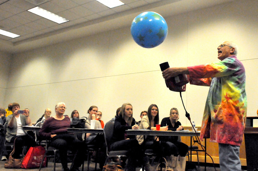 . Retired science teacher Jerry Wenzel demonstrates the power of air pressure during a workshop aimed at enhancing the way teachers teach science in the classroom. (Pioneer Press: John Doman)