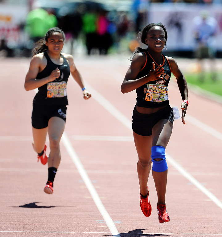 . Laura Anuakpado, right, of South Pasadena finished second in the 400 meter dash invitational high school during the Mt. SAC Relays in Hilmer Lodge Stadium on the campus of Mt. San Antonio College on Saturday, April 20, 2012 in Walnut, Calif.    (Keith Birmingham/Pasadena Star-News)
