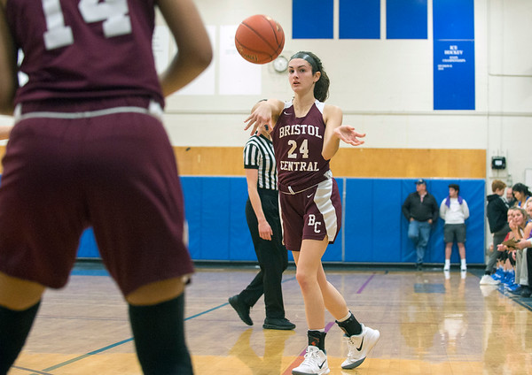 01/27/20 Wesley Bunnell | StaffrrBristol Central girls basketball was defeated in an away game at Lewis Mills on Monday night. Sophia Torreso (24) passes to Janessa Bartel (14).