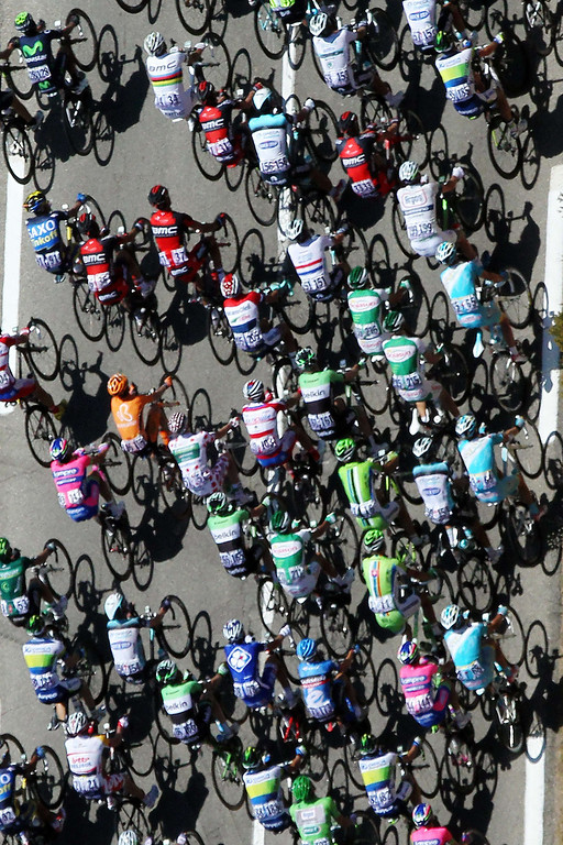 . An aerial view shows the pack riding during the 145.5 km third stage of the 100th edition of the Tour de France cycling race on July 1, 2013 between Ajaccio and Calvi, on the French Mediterranean Island of Corsica. AFP PHOTO POOL / PASCAL POCHARD-CASBIANCA/AFP/Getty Images