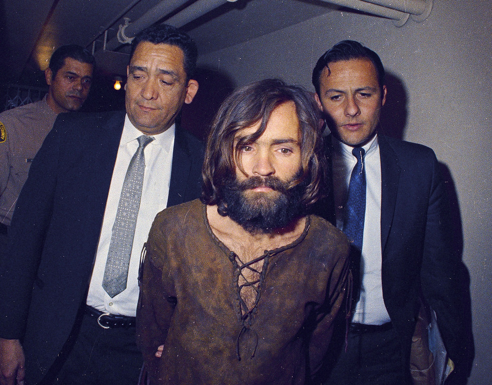 . Charles Manson is escorted to his arraignment on conspiracy-murder charges in conneciton with the Sharon Tate murder case, 1969, Los Angeles, Calif.  (AP Photo)