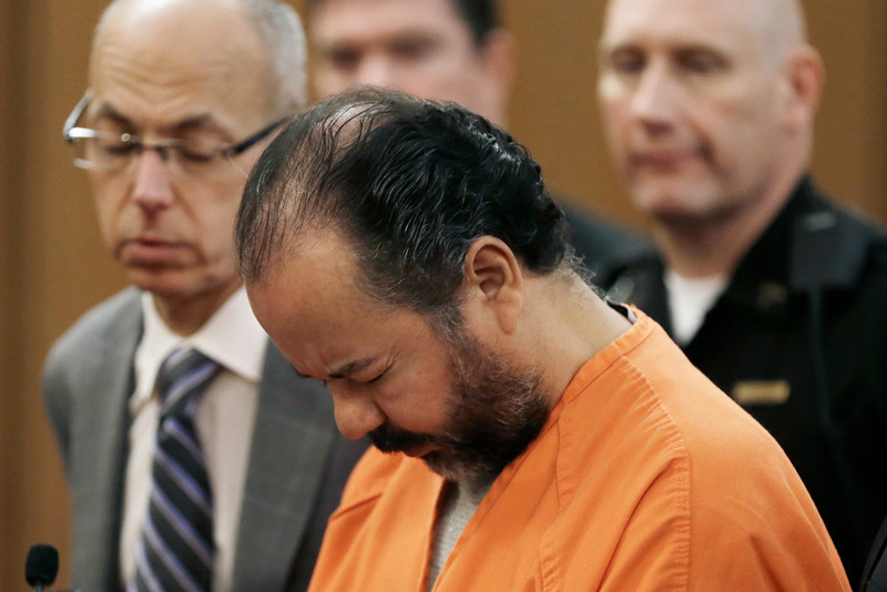 . FILE - Ariel Castro stands before a judge during his arraignment Wednesday, June 12, 2013, in Cleveland. Castro, who held 3 women captive for a decade, has committed suicide, Tuesday, Sept. 3, 2013.  (AP Photo/Tony Dejak)