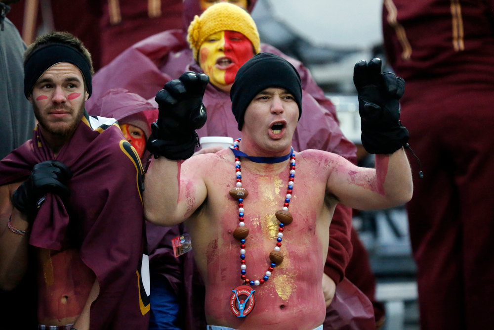 . Louisiana-Monroe fans brave the cold winds to cheer for their team against Ohio in the Independence Bowl NCAA college football game in Shreveport, La., Friday, Dec. 28, 2012. Ohio won 45-14. (AP Photo/Rogelio V. Solis)