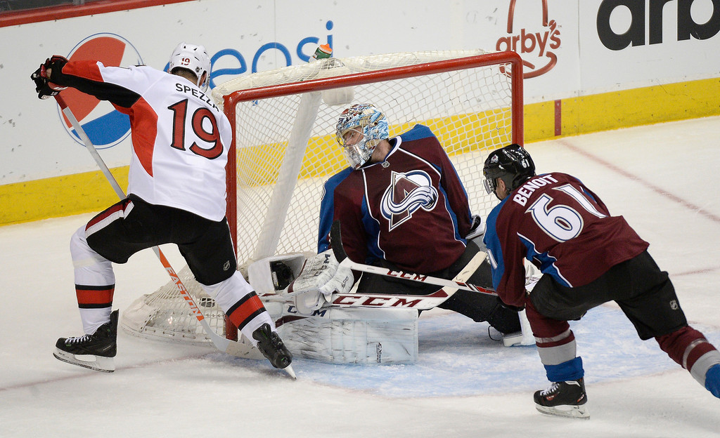 . Ottawa Senators center Jason Spezza (19) scores a goal on Colorado Avalanche goalie Semyon Varlamov (1) as he sneaks the puck in below his right leg pad during the second period January 8, 2014 at Pepsi Center. (Photo by John Leyba/The Denver Post)