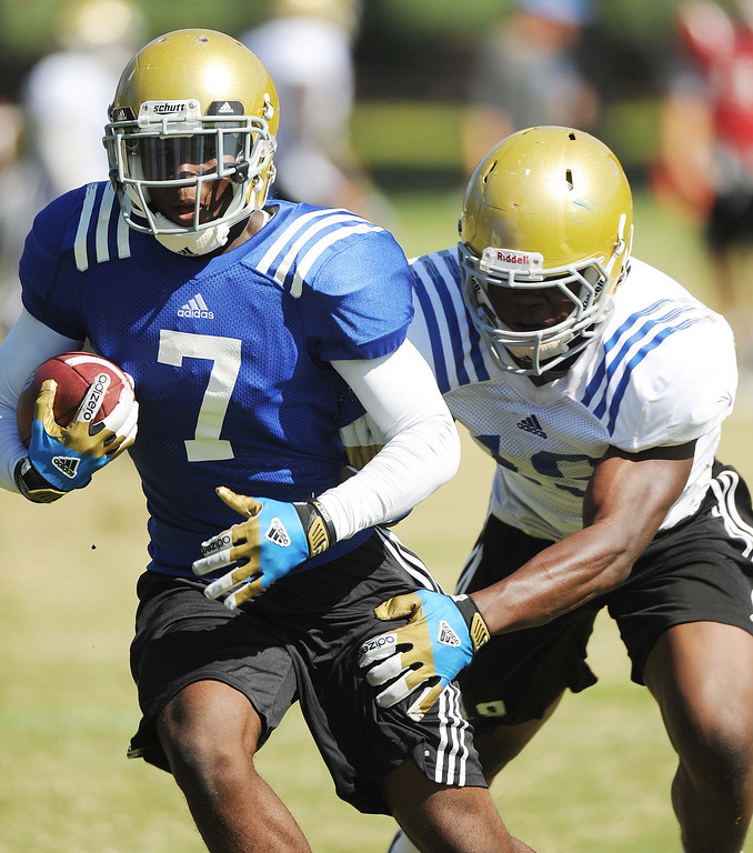 . Wide Receiver Devin Fuller works out a play during UCLA football practice held at California State University San Bernardino August 14, 2013.LaFonzo Carter/ Staff Photographer