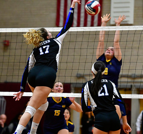 11/14/2018 Mike Orazzi | Staff Bristol Eastern's Gabriella Nozzolillo (17) and Woodstock Academy's Katherine Papp (18) during the Class L Semifinal State Girls Volleyball Tournament held at Windsor High School Wednesday night.