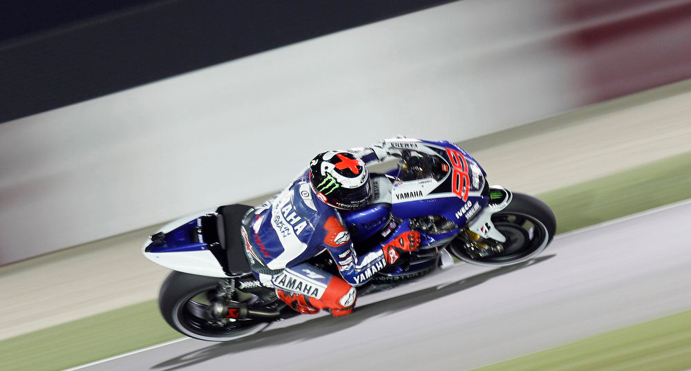 . Yamaha MotoGP rider Jorge Lorenzo of Spain rides during a free practice for the Qatar Grand Prix at Losail International Circuit in Doha April 4, 2013. REUTERS/Mohammed Dabbous