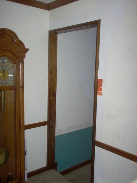 Den doorway - wooden door frame and trim added