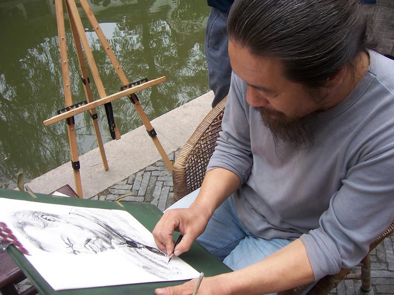 Funny artist doing my portrait  in Zhu Jia Jiao, nr Shanghai