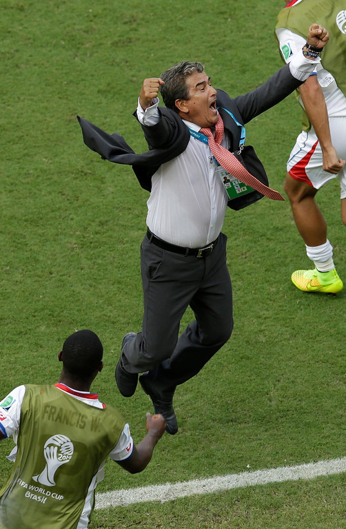 . Costa Rica\'s head coach Jorge Luis Pinto celebrates after the group D World Cup soccer match between Italy and Costa Rica at the Arena Pernambuco in Recife, Brazil, Friday, June 20, 2014. Costa Rica beat four-time champion Italy 1-0 to secure a spot in the next round. (AP Photo/Hassan Ammar)