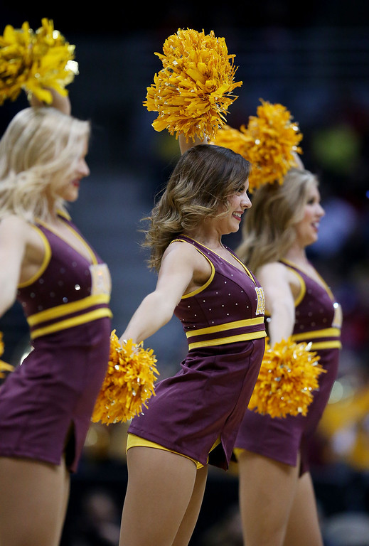 . Arizona State Sun Devils cheerleaders perform in the first half against the Texas Longhorns during the second round of the 2014 NCAA Men\'s Basketball Tournament at BMO Harris Bradley Center on March 20, 2014 in Milwaukee, Wisconsin.  (Photo by Jonathan Daniel/Getty Images)
