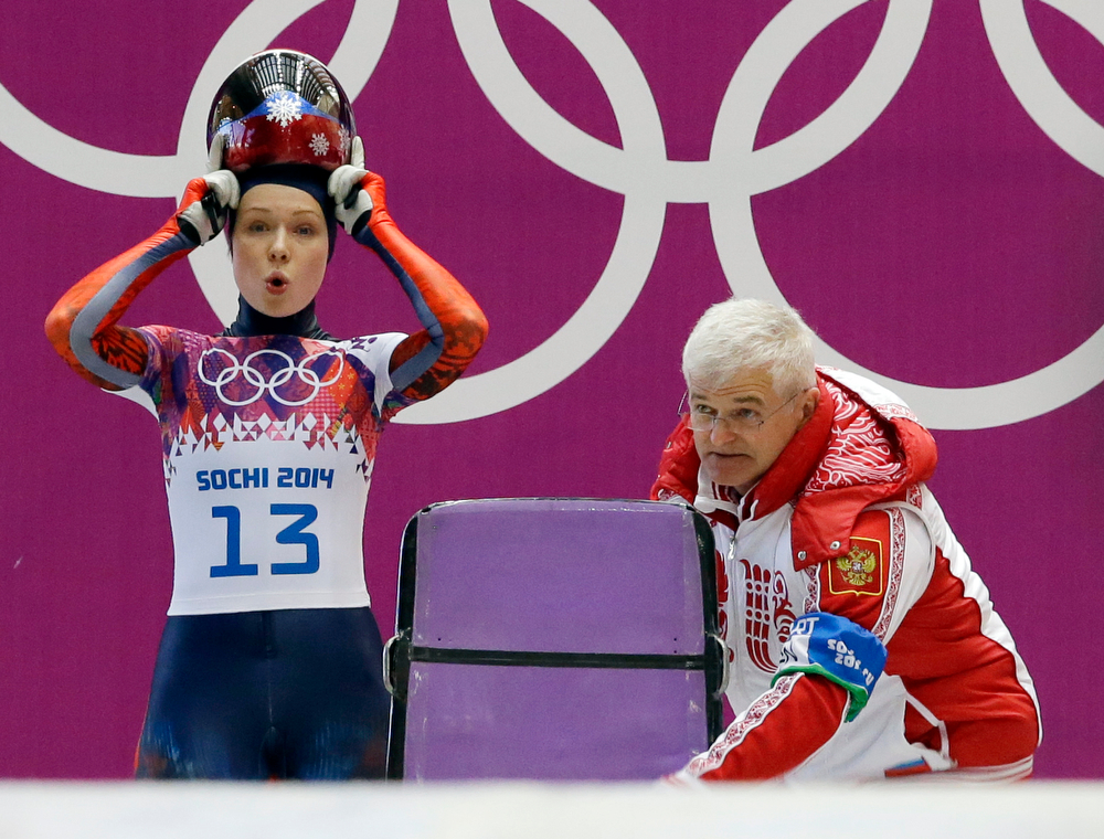 . Olga Potylitsina of Russia prepares to start her first run during the women\'s skeleton competition at the 2014 Winter Olympics, Thursday, Feb. 13, 2014, in Krasnaya Polyana, Russia. (AP Photo/Dita Alangkara)