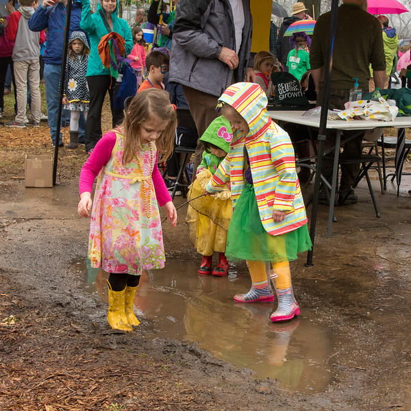 """Naomi Johnson, 2 center; Caroline Camp, 3 right; and Lottie Woodruff, 5 left, of College Heights make a wonderful statement about how to have fun at a very rainy """"Muddy Gras"""" for 2018"""
