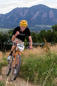 Sam Weinberg (491) having fun while competing in the Single Speed race in the CU Short Track Series at Valmont Bike Park, Boulder, Colorado.