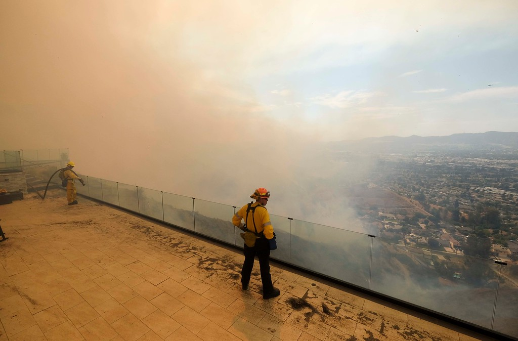 . Fire Flighters watch a brushfire on the hillside in Burbank, Calif., Saturday, Sept. 2, 2017. Several hundred firefighters worked to contain a blaze that chewed through brush-covered mountains, prompting evacuation orders for homes in Los Angeles, Burbank and Glendale. (AP Photo/Ringo H.W. Chiu).