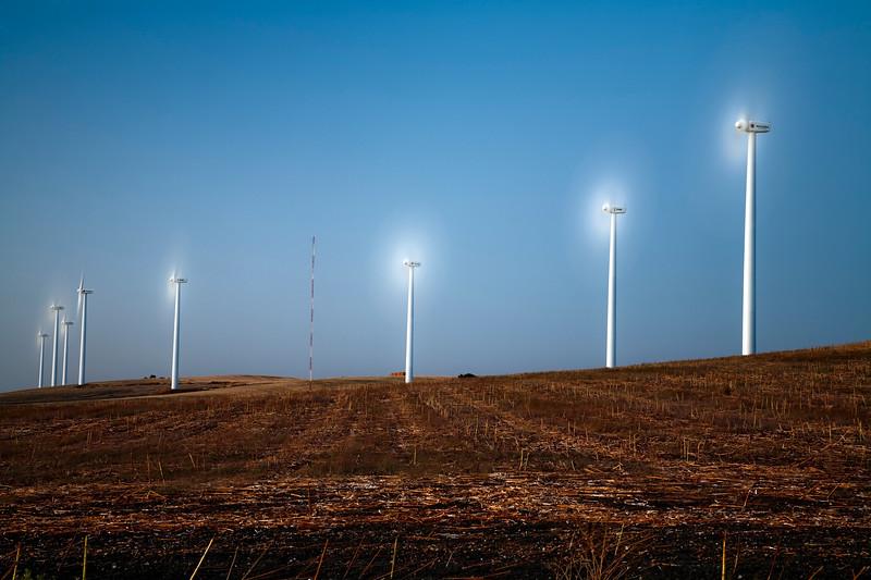 Electric generating windmills at dusk, town of Sanlucar de Barrameda, province of Cadiz, Andalusia, Spain.