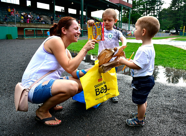 8/22/2019 Mike Orazzi | Staff Magdalena Chmura and her children Jakub,4 and Adam,2, look over prizes they received during the second annual Mayors Back to School Pencil Hunt held at Muzzy Field in Bristol on Thursday evening.