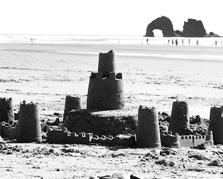 2 very different kinds of architecture in the same shot. One created by mother nature...the other by kids in the sand