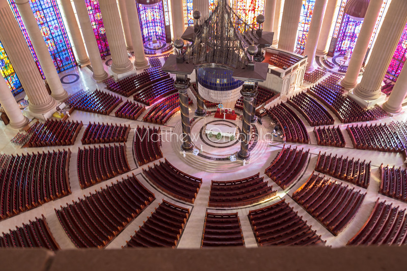 Main altar and nave with curved Iroko pews of the Basilica of Our Lady of Peace Basilique Notre Dame de la Paix Yamoussoukro Ivory Coast Cote d'Ivoire West Africa. The largest church in the world.