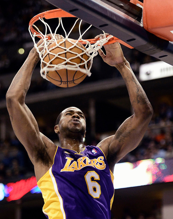 . Los Angeles\' Lakers Earl Clark gets slam dunk on the Denver Nuggets during their NBA basketball game in Denver, Colorado February 25, 2013.   REUTERS/Mark Leffingwell