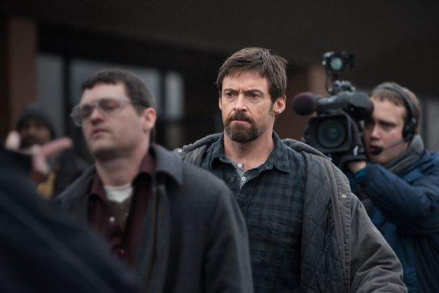 ". This image released by Warner Bros. Pictures shows Hugh Jackman in a scene from ""Prisoners.\"" (AP Photo/Warner Bros. Pictures, Wilson Webb)"