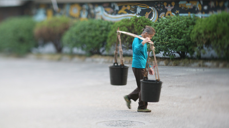 Woman with Buckets & Mural, Guilin, China