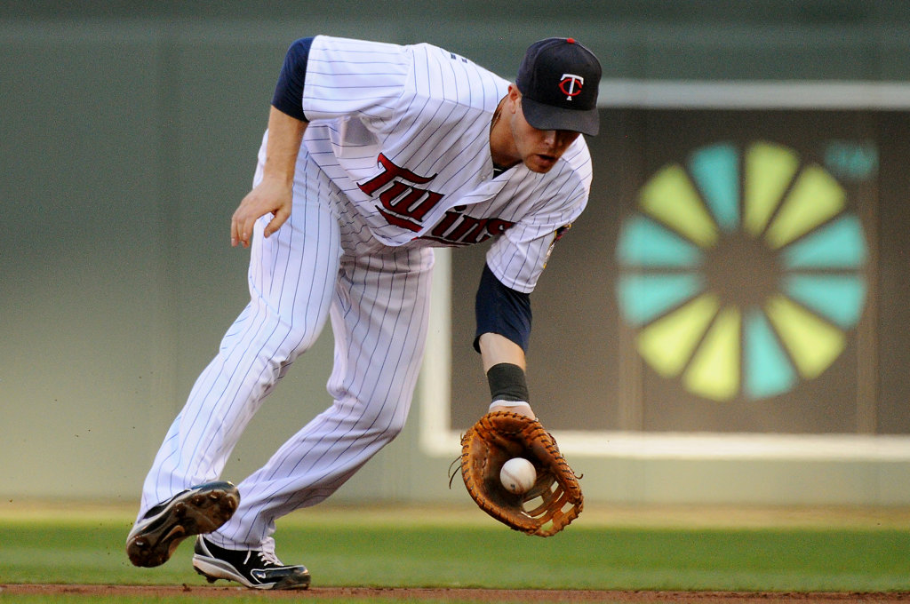 . Twins first baseman Justin Morneau snags a ball hit by New York\'s Lyle Overbay for the force at first during the second inning. (Pioneer Press: John Autey)