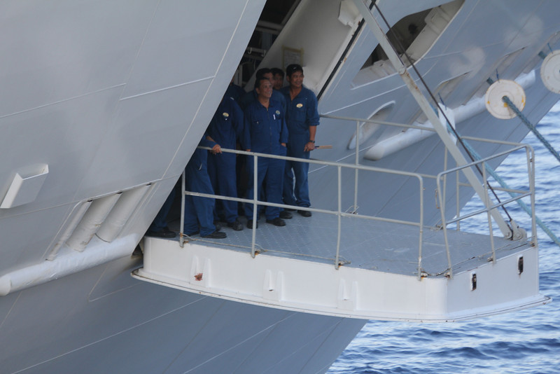 crewmen on the ship next to ours