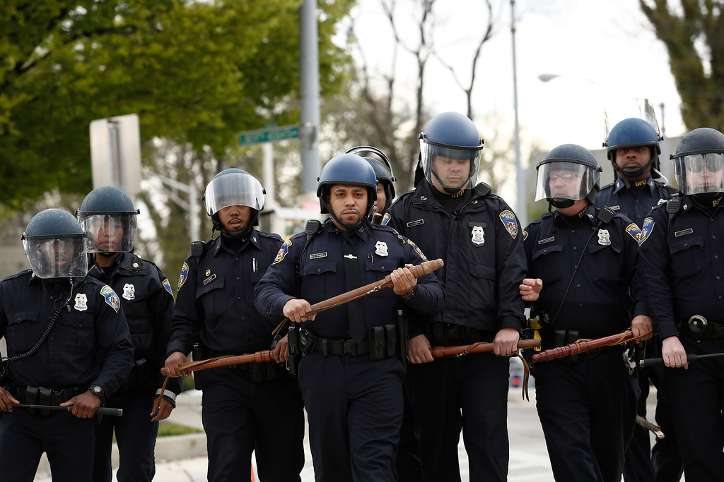 . BALTIMORE, MD - APRIL 27:  Baltimore Police officers in riot gear walk toward protestors along Reisterstown Road near Mondawmin Mall, April 27, 2015 in Baltimore, Maryland. A group of young protestors clashed with police in the streets near Mondawmin Mall in the afternoon following Freddie Gray\'s funeral. (Drew Angerer/Getty Images)