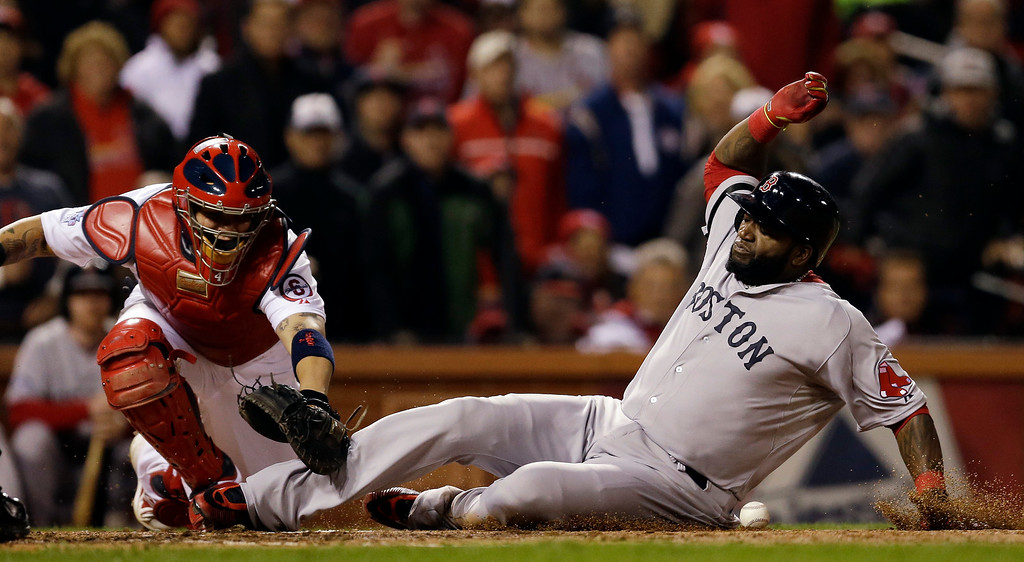 . Boston Red Sox\'s David Ortiz slides safely past St. Louis Cardinals catcher Yadier Molina during the fifth inning of Game 4 of baseball\'s World Series Sunday, Oct. 27, 2013, in St. Louis. Ortiz scored from third on a sacrifice fly by Stephen Drew. (AP Photo/Jeff Roberson)