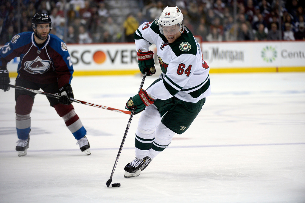 . Mikael Granlund (64) of the Minnesota Wild takes the puck up ice during the second period of action. The Colorado Avalanche hosted the Minnesota Wild in the first round of the Stanley Cup Playoffs at the Pepsi Center in Denver, Colorado on Saturday, April 19, 2014. (Photo by John Leyba/The Denver Post)