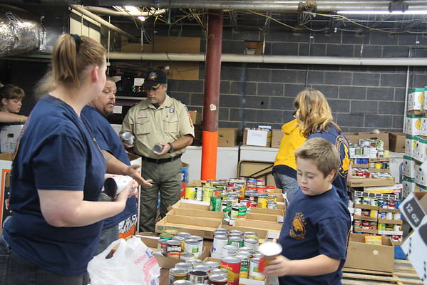 2012,  Scouts (Pack 143) sort food for Scouting for Food food drive