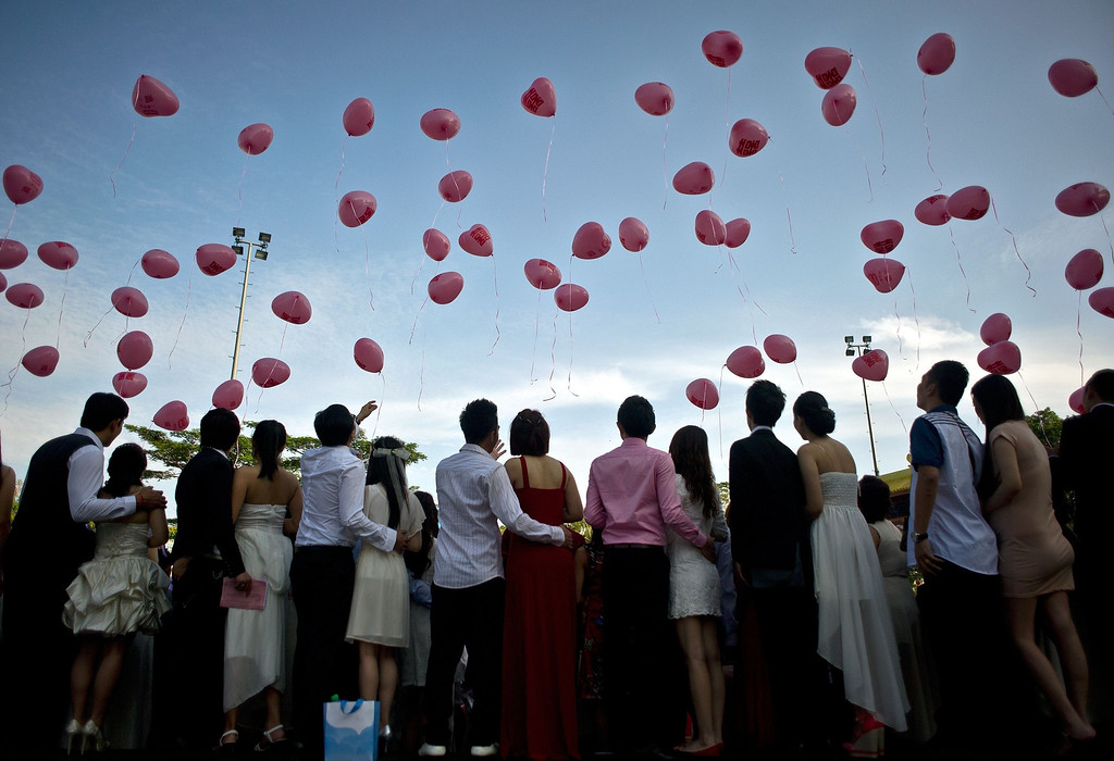 . Newly-wed ethnic Malaysian-Chinese couples release heart-shaped balloons during their mass wedding ceremony on Valentine\'s Day at the Thean Hou Temple in Kuala Lumpur on February 14, 2014. Some 138 couples married on Valentines day, coinciding with Chap Goh Meh marking the end of Chinese Lunar New Year celebrations, also believing to bring them good luck.   AFP PHOTO / MANAN VATSYAYANA/AFP/Getty Images