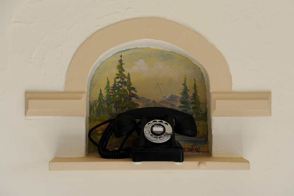 . DENVER, CO - NOVEMBER 13: A telephone nook beside the front door of the Spicer residence on November 13, 2013, in Denver, Colorado. The painting behind the phone is an original dating back to 1936. (Photo by Anya Semenoff/YourHub)